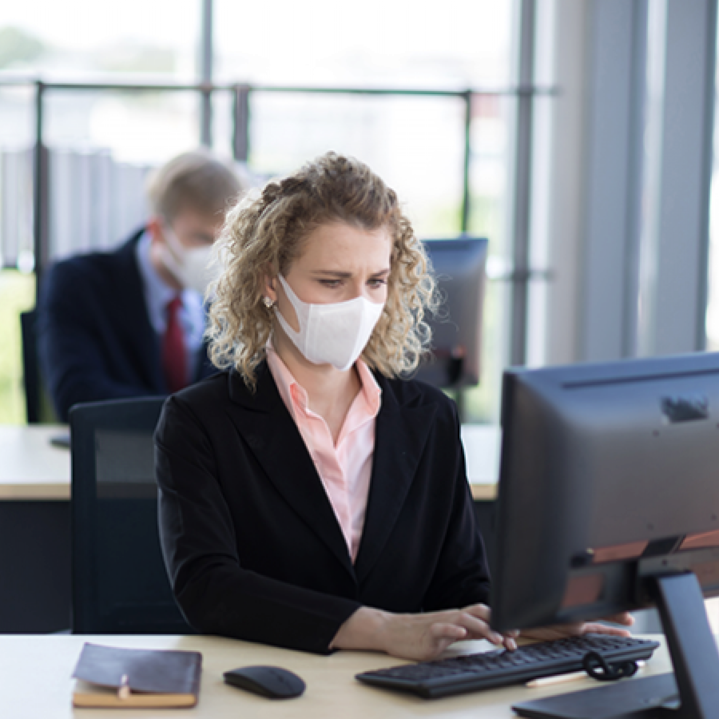 image of office worker with facial mask
