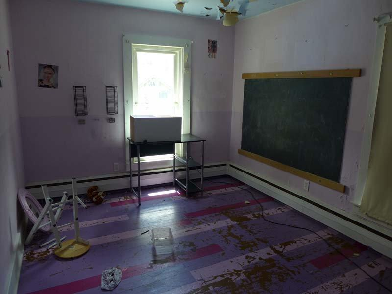 Photo of bedroom with chalkboard